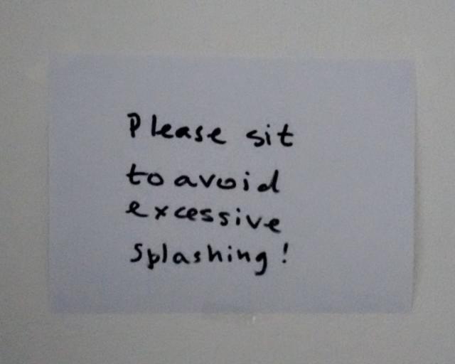 """""""please sit"""" sign"""