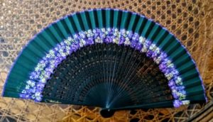 dark green fan with blue flowers