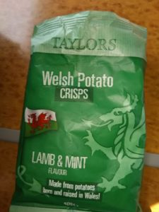 green bag labelled Welsh Potato CRISPS, Lamb & Mint flavour