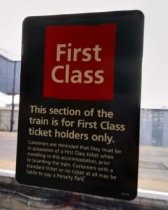 Sign saying that first class is for first class ticket holders only.